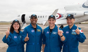 Nasa astronauts Shannon Walker, Victor Gover and Michael Hopkins, along with Soichi Noguchi of the Japan Aerospace Exploration Agency (Jaxa), board a plane from Houston, Texas, en route to the Kennedy Space Center in Florida.