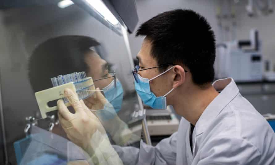 A researcher in Beijing works on an experimental coronavirus vaccine