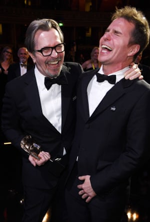 Gary Oldman and Sam Rockwell share a laugh