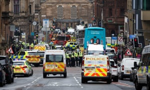 Police and emergency services at the scene of the attack in central Glasgow