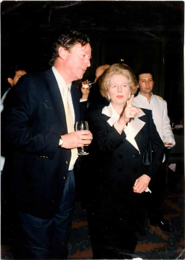 Mount with Margaret Thatcher at a party in London, April 1992.