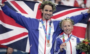 Gail Emms and Nathan Robertson celebrate winning their silver medals at the Athens Olympics in 2004.