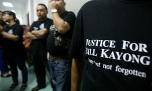 Supporters of Bill Kayong outside the court at the trial of three men charged in his murder