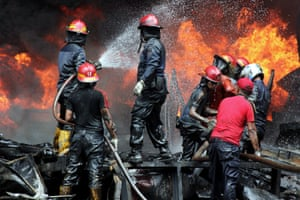Firefighters tackle an enormous warehouse blaze in West Sumatra, Indonesia