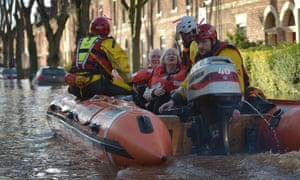 A rescue team helps to evacuate people from their homes after Storm Desmond caused flooding on 6 December 2015 in Carlisle.