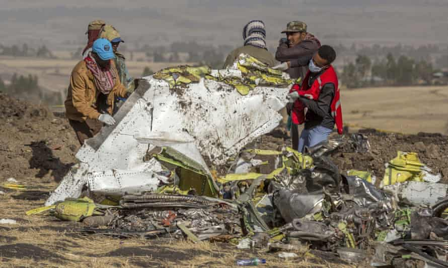 Rescuers work at the scene of an Ethiopian Airlines flight crash near Bishoftu, or Debre Zeit, south of Addis Ababa, Ethiopia.