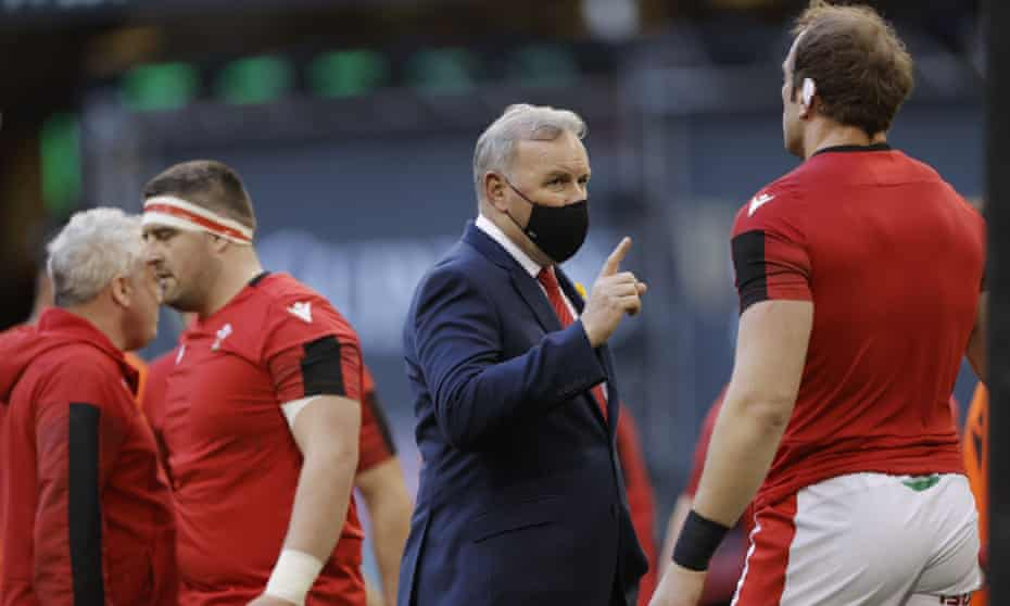 The Wales head coach, Wayne Pivac (centre), speaks to Alun Wyn Jones during the warmup before the Six Nations victory against England at Principality Stadium.