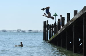 A man dives into the sea at Southend Beach