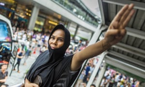 A woman protests against the Thai military coup with the three-fingered salute of defiance from the film, which was banned. Bangkok 2014