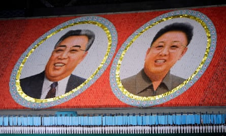 North Korean students form portraits of late North Korean leaders Kim Il-sung (left) and Kim Jong-il in 2013.