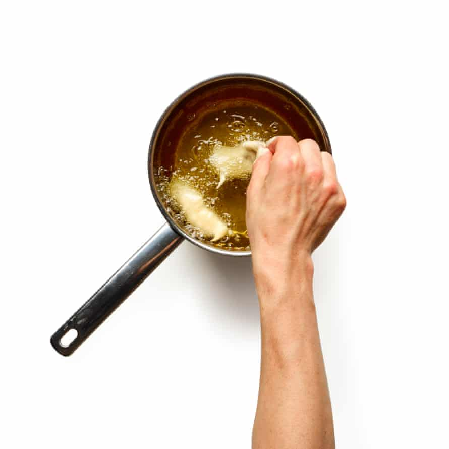 Dip the fish in the batter, shake off any excess and deep-fry in batches for four minutes, turning once halfway.