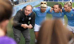 Manchester City Women's manager Nick Cushing gives a team talk to his players prior to this season's Women's Super League match against Birmingham City.