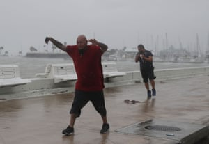 As Hurricane Harvey heads for the Texas coast, bringing with it a predicted three feet of rain and 125 mph winds, Raul Barral and Carlos Guerra walk through the gusts and driving rain in Corpus Christi