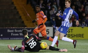 Jermain Defoe of Rangers slides the ball past the Kilmarnock goalkeeper Daniel Bachmann and the post in the sides' goalless draw at Rugby Park.