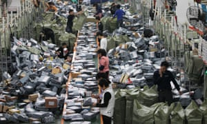 Parcels at a sorting centre in Beijing ahead of Singles' Day. Last year 27,000 merchants took part, with Alibaba's e-commerce sites generating $9.3bn (£6.1bn) in sales.