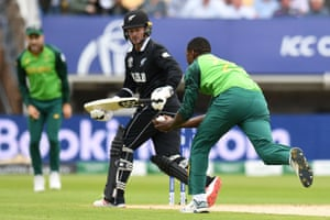 South Africa's Kagiso Rabada catches the ball to take the wicket of New Zealand's Colin Munro for nine runs.