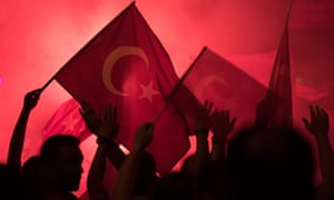People shout slogans and hold Turkish national flags during a demonstration, against the failed Army coup attempt, at Taksim Sqaure, in Istanbul