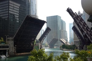 Bridges across the Chicago river are raised to control access into downtown as widespread looting broke out in the city on 10 August.