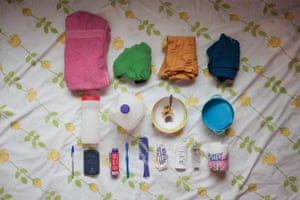 Chadla's bag: towel, baby clothes, bottles, bowl, cup, comb, toothbrush and paste, deodorant, perfume, loo roll, biro, notebook