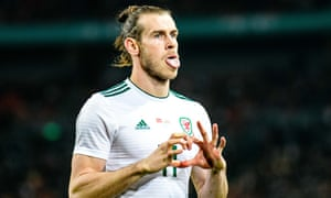 Gareth Bale celebrates his first goal against China as he caught and overtook Ian Rush as the all-time top goalscorer for Wales.