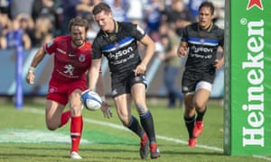 Maxime Médard prepares to knock the ball from Freddie Burns' hand before the Bath player can touch down
