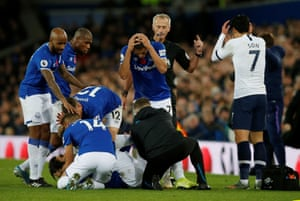 Everton's Andre Gomes lies on the turf with a serious ankle injury after being fouled by Tottenham Hotspur's Son Heung-min. The Tottenham player was in tears and left the field after being red carded. Everton later scored an equaliser to earn a 1-1 draw.