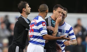 Chelsea's John Terry, covering his mouth, and QPR's Anton Ferdinand at Loftus Road in 2011.