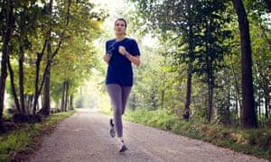 woman running through a woodland