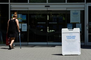A woman enters a cooling centre in Vancouver