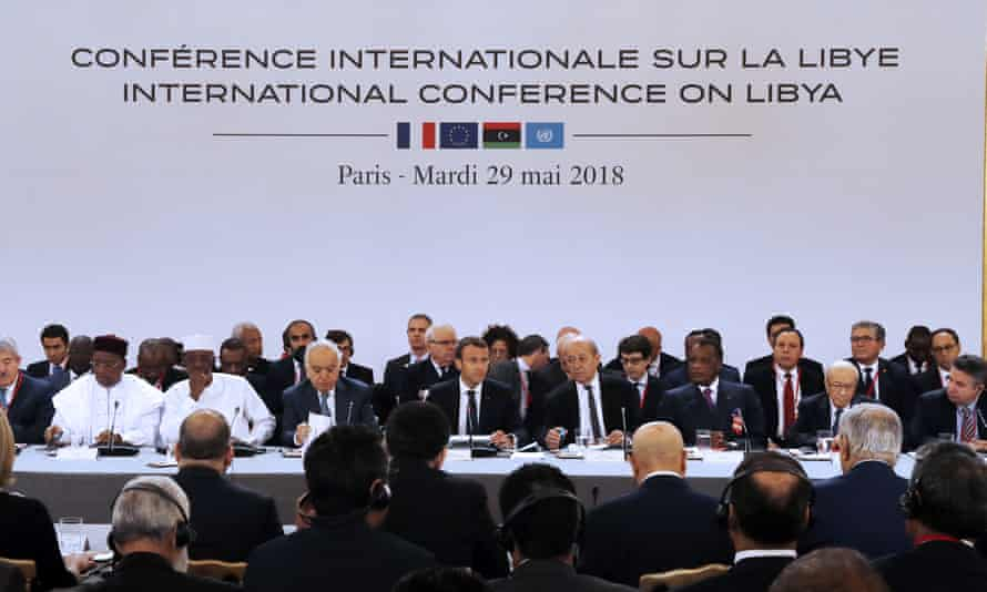 Emmanuel Macron, centre, at the Libya conference at the Élysée Palace