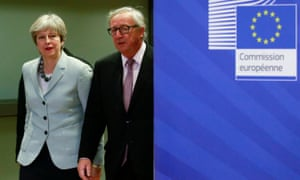 Theresa May is welcomed by the EU commission president, Jean-Claude Juncker, before their breakfast meeting.
