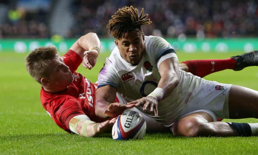 Gareth Anscombe beat England's Anthony Watson to the ball, but the try was disallowed.