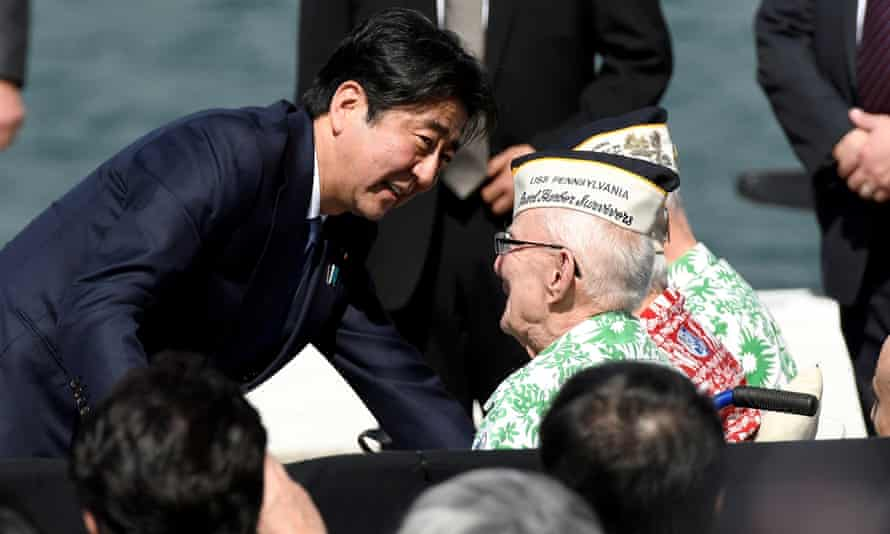 Shinzo Abe smiles after giving a hug to Pearl Harbor survivor Everett Hyland.