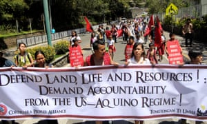 Indigenous activists, with women playing a prominent role, march in support of their rights at Baguio City on Luzon.