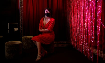 Aya Yumiko poses during lockdown in a bar in Kabukicho where she used to perform as a burlesque dancer.
