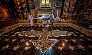 Liverpool, UK. Part of the Peace Doves art installation at Liverpool Cathedral, visitors are asked to place a button in a dove on the floor in memory of people who have died in the past year