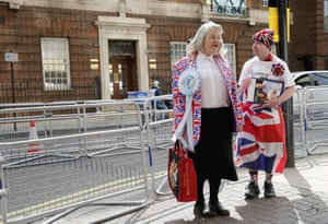 Fans of the royal family stand outside the Lindo Wing