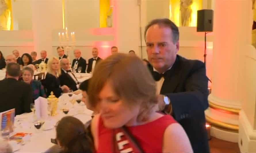 Tory MP Mark Field manhandled a protester at a City dinner.