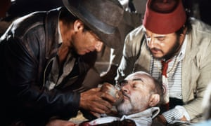 Harrison Ford, left, with John Rhys-Davies, tends to his father, Sean Connery, in Indiana Jones and the Last Crusade.