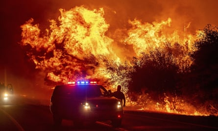 Flames near Highway 162 as the Bear Fire burns in Oroville, California.