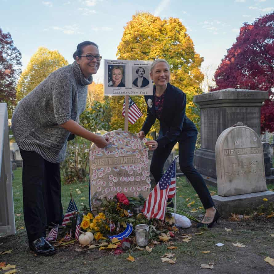 Women place 'I voted' stickers on the grave of women's suffrage leader Susan B Anthony in Rochester, New York.