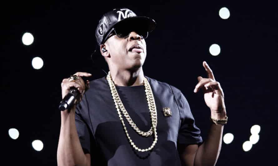 Jay-Z performs during a concert as part of his tour Watch the Throne at Bercy in Paris