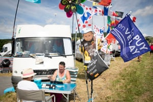 Spectators play rummy while their campervans are parked up on the side of the road near Col de Peyra Taillade