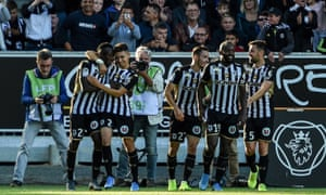 Casimir Ninga (far left) takes the acclaim of his Angers teammates after his decisive impact from the bench.