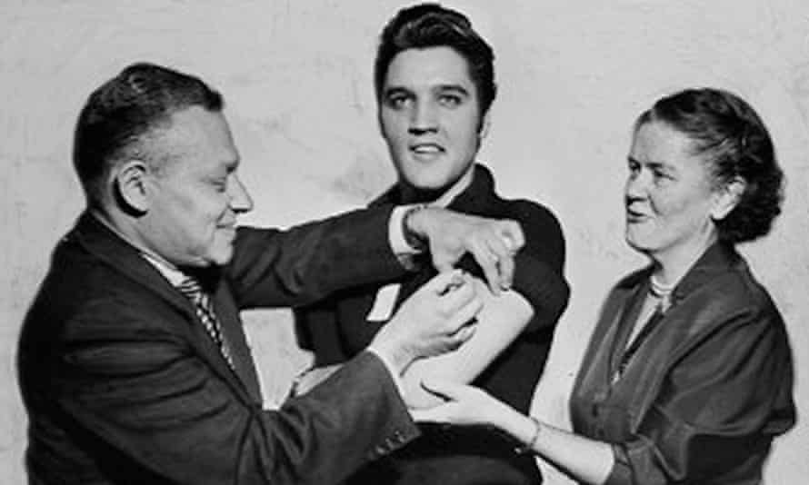 Elvis Presley receives a polio vaccination from doctors at the CBS studios, New York, in 1956.
