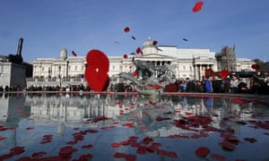 London, UK Poppies are thrown into the fountain in Trafalgar Square to mark Armistice Day