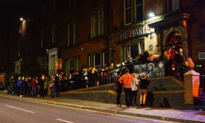Queues outside The Harley at night