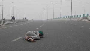 An Indian farmer sleeps on a highway at the Delhi-Uttar Pradesh border. With nearly 60% of the Indian population depending on agriculture for their livelihoods, the prime minister, Narendra Modi's administration cannot afford to ignore the rebellion