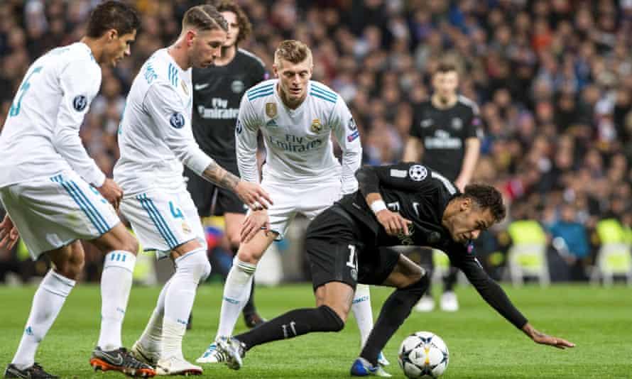 Sergio Ramos and Toni Kroos keep an eye on Neymar.