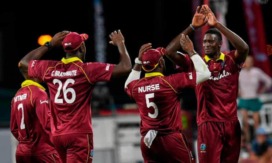 West Indies captain Jason Holder (right) leads the celebrations.